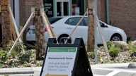 A car stops to pick up reemployment forms Friday, April 17, 2020, at the Jimmie B. Keel Regional Library in Tampa, Fla…