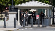 A Secret Service Police Officer works outside of the guard entrance on 17th St Northwest near the White House in Washington,…
