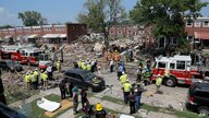 Rescue officials work near the rubble in the aftermath of an explosion in Baltimore, Monday, Aug. 10, 2020. Baltimore…