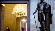 A statue of President George Washington is visible as House Speaker Nancy Pelosi of Calif., center right and Senate Minority…