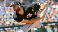 FILE - In this March 6, 2020, file photo, Chicago White Sox starter Lucas Giolito pitches in the first inning of a spring…