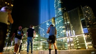 People watch the Tribute in Light in Lower Manhattan, Wednesday, Sept. 11, 2019, in New York. Each year the city shines the…