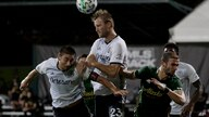 Philadelphia Union forward Kacper Przybylko, top, heads the ball against the Portland Timbers during the second half of an MLS…