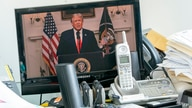 U.S President Donald Trump is seen on a video screen remotely addressing the 75th session of the United Nations General…