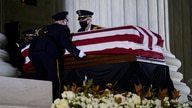 A Supreme Court Honor Guard moves the flag-draped casket of Justice Ruth Bader Ginsburg back into the court as Ginsburg lies in…