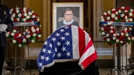 Justice Ruth Bader Ginsburg lies in state in Statuary Hall of the U.S. Capitol in Washington on Friday, Sept. 25, 2020. (Shawn…