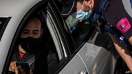 A local police stops a vehicle at a checkpoint in Madrid, Spain, Monday, Sept. 21, 2020. Police in the Spanish capital and its…