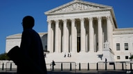 Officials stand on the Supreme Court steps on Capitol Hill in Washington, Tuesday, Sept. 22, 2020, as preparations take place…