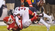 Kansas City Chiefs running back Clyde Edwards-Helaire (25) loses the ball as he is hit by Houston Texans safety A.J. Moore Jr. …