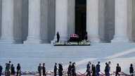 People pay respects as Justice Ruth Bader Ginsburg lies in repose under the Portico at the top of the front steps of the U.S…