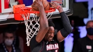 Miami Heat's Bam Adebayo (13) slams home a backward dunk during the second half of an NBA conference final playoff basketball…