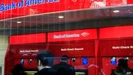 In this Jan. 31, 2011 photo, Bank of America customers use ATM machines in New York. Truly free checking accounts are becoming…