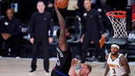 Los Angeles Clippers forward JaMychal Green (4) drives to the basket over Denver Nuggets forward Mason Plumlee (7) during the…