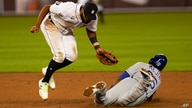 Kansas City Royals' Erick Mejia steals second base under the tag of Detroit Tigers shortstop Willi Castro (49)in the ninth…