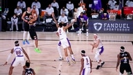 Denver Nuggets guard Jamal Murray, left, goes up to take a shot as Los Angeles Lakers' Kyle Kuzma (0) defends during the second…