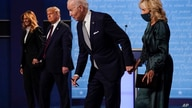 From l-r, first lady Melania Trump, President Donald Trump, Democratic presidential candidate former Vice President Joe Biden…