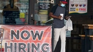 FILE - In this Sept. 2, 2020, file photo, a customer walks past a now hiring sign at an eatery in Richardson, Texas. The Labor…
