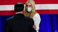 Daughter and adviser of President Donald Trump, Ivanka Trump, right, speaks with Arizona Gov. Doug Ducey, left, after they…