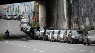 Vehicles line up near a gas station to fill their tanks in Caracas, Venezuela, Tuesday, Sept 8, 2020. Gasoline shortages have…