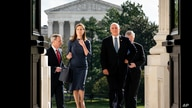 Judge Amy Coney Barrett, President Donald Trump's nominee to the Supreme Court and Vice President Mike Pence arrive at the…