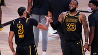 Los Angeles Lakers' LeBron James (23) celebrates with teammate Anthony Davis (3) after an NBA conference final playoff…