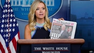 White House press secretary Kayleigh McEnany displays a copy of the New York Post as she speaks during a news conference at the…