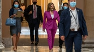 House Speaker Nancy Pelosi of Calif., center, walks to her office, Monday, Sept. 14, 2020, on Capitol Hill in Washington. (AP…