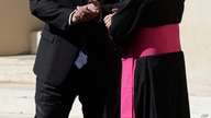 U.S. Secretary of State Mike Pompeo, left, greets Monsignor Joseph Murphy, head of Vatican protocol, after meeting Vatican…