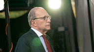White House chief economic adviser Larry Kudlow speaks before a television interview at the White House, Friday, Oct. 23, 2020,…