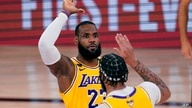 Los Angeles Lakers' LeBron James (23) high-fives Anthony Davis during the second half of Game 1 of basketball's NBA Finals…