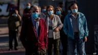 People queue for a rapid antigen test for COVID-19 in the southern neighbourhood of Vallecas in Madrid, Spain, Thursday, Oct. 1…