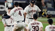 Houston Astros George Springer (4) celebrates with teammates after Game 4 of a baseball American League Championship Series…