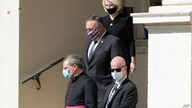 Monsignor Joseph Murphy, head of Vatican protocol, bottom left, is followed by U.S. Secretary of State Mike Pompeo and U.S…