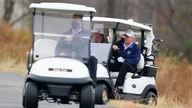 President Donald Trump drives a golf cart as he golfs at Trump National Golf Club in Sterling, Va., Sunday, Nov. 22, 2020. (AP…