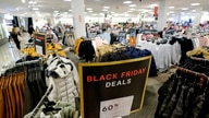 "A ""Black Friday Deals"" sign is displayed as a few shoppers are seen at a store at the Glendale Galleria in Glendale, Calif.,…"
