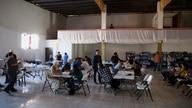 In this Oct. 26, 2019, photo, volunteer health practitioners set up a clinic in a shelter for migrants in Tijuana, Mexico. The…