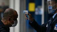 A man gets his temperature taken as a measure to curb the spread of the new coronavirus, at the entrance of El Recreo mall in…