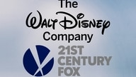 The Walt Disney Company and 21st Century Fox logos, on texture, partial graphic