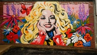 A mural of Dolly Parton is seen outside The 5 Spot, a music club in Nashville, Tenn., Friday, Aug. 21, 2020. Artist Kim Radford…