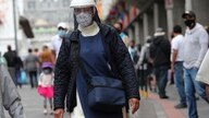 A nun wearing a mask and face shield to avoid the risk of COVID-19 contagion walks in Quito, Ecuador, Tuesday, Dec. 8, 2020. …