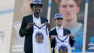 Golden State Warriors draft picks James Wiseman, left, and Nico Mannion pose for photos at a news conference in San Francisco,…