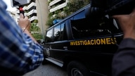 A military police car (DGCIM) leaves the building where the family of Juan Jose Marquez lives in Caracas, Venezuela, Thursday,…