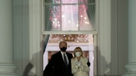 President Joe Biden and first lady Jill Biden watch fireworks from the White House, Wednesday, Jan. 20, 2021, in Washington. …