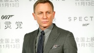 FILE - In this Nov. 10, 2015 file photo, British actor Daniel Craig poses for photographers before a press conference for the…
