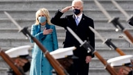 President Joe Biden and his wife Jill Biden watch a military pass in review ceremony on the East Front of the Capitol at the…