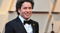 FILE - In this Feb. 24, 2019, file photo, Music & Artistic Director of LA Philharmonic Gustavo Dudamel arrives at the Oscars at…
