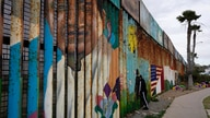 A man looks through the first wall at Friendship Park, near where the border separating Tijuana, Mexico, and San Diego meets…