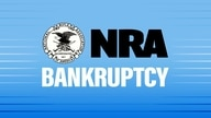 National Rifle Association NRA seal and lettering logo, on texture with BANKRUPTCY lettering, finished graphic