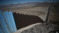 An older section of the border wall divides Ciudad Juarez, Mexico from Sunland Park, New Mexico, top, on the outskirts of…