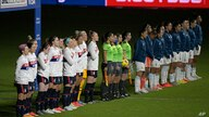 Players from the United States, left, and Argentina teams stand during the national anthems before a SheBelieves Cup women's…